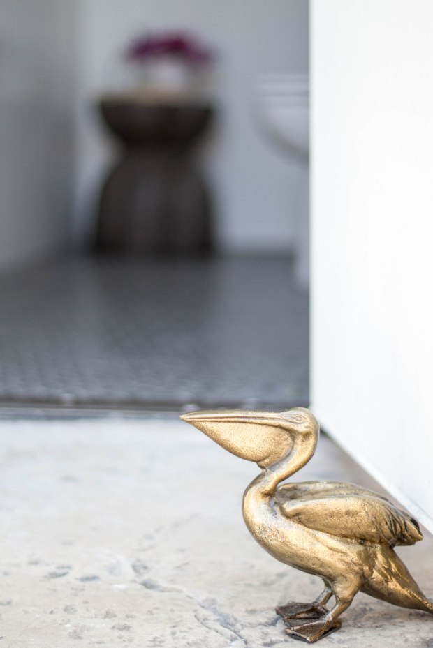 koa-house_pool-bathroom-black-and-white-brass-pelican-doorstop-cb2-tile-shop-gatsby_