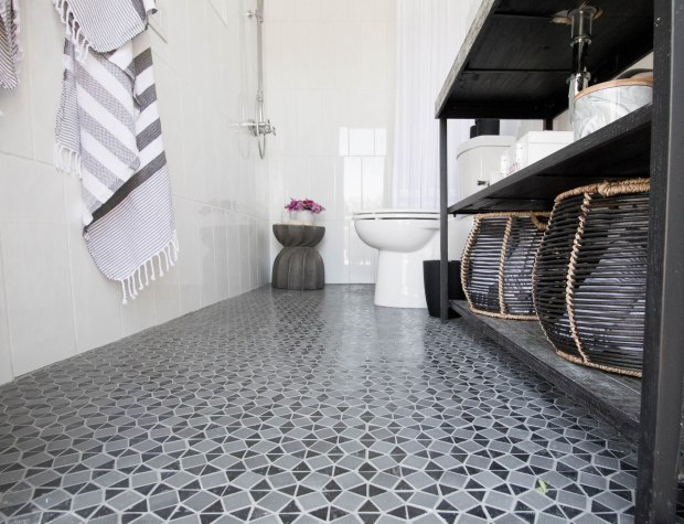 koa-house_pool-bathroom-gatsby-tile-black-and-white-modern-toilet-cement-side-table-shower-2