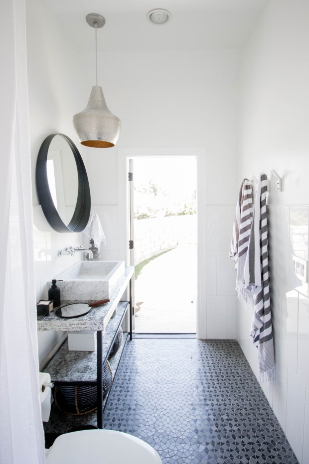 koa-house_pool-bathroom-gatsby-tile-white-cb2-crescent-mirror-hammered-silver-pendant-custom-vanity-silver-leaf-2